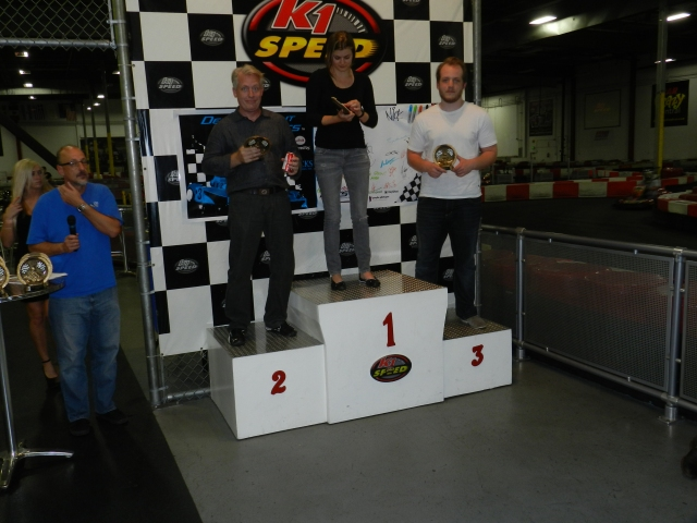 The F-Main Podium - Jacqueline Reeve from Nissan, and Alexander and Phillip Klatt from Fisker