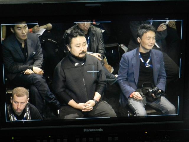 Kazunori Yamauchi, right, enjoys the AMG Gran Turismo Vision Concept