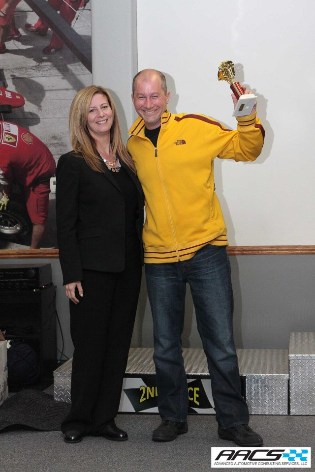 Lisa Caleca of Recaro awards Mike Rossey of Chrysler his 3rd Place trophy