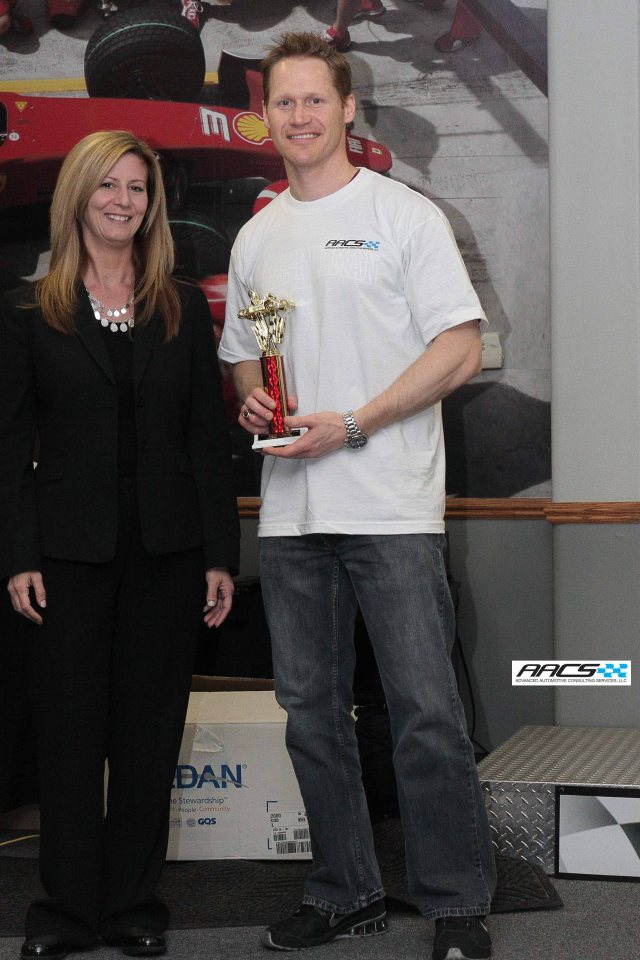 Addam Ebel of GM accepts the 2nd place trophy from Lisa Caleca of Recaro
